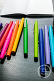 Dollar Stock Photo 158 Colorful Pens and Small Notebook on