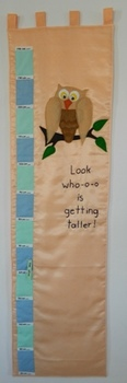 """Look who-o-o- is getting taller!"" Owl Wall Growth and Mea"