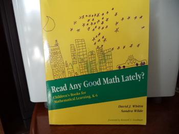 Read any Good Math Lately?  ISBN#0-435-08334-1