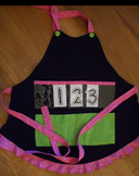 Show and Tell Apron (black with green pocket/pink polka trim)