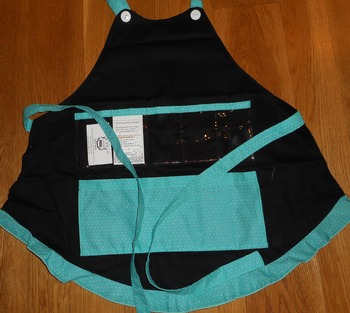 Show and Tell Apron (black with teal/tiny white polkas)