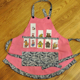 Show and Tell Apron (pink apron with black and white paisl