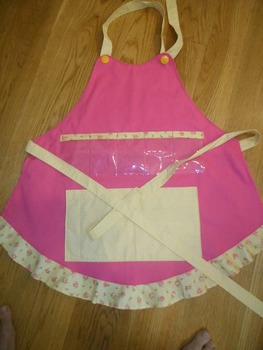 Show and Tell Apron (pink with yellow floral ruffle and ye