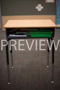 "Stock Photo: Prepositions ""In"" or ""Inside"" The Desk-Person"