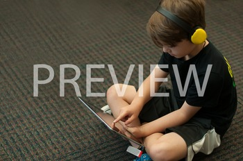 Stock Photo: Student Listening with an iPad #3-Personal &